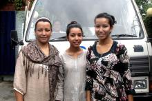 Bhutanese refugees Suman Basnet with her daughters Emma and Numa, hours before their resettlement to the USA. © IOM 2014