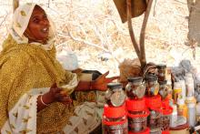Hadidja Mahamat returned from Libya in 2011. She sells incense in the Market of Libya to survive in Chad. © IOM 2012