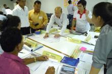 Fonctionnaires thaïlandais prenant part aux formations organisées par l'OIM/USAID/OFDA en septembre à Bangkok, qui leur permettront d'être mieux préparés en cas de catastrophe. © OIM 2013