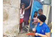 IOM Haiti staff carrying out emergency assessments in a Port-au-Prince camp. Photo: IOM Haiti