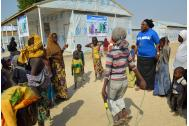 Children play outside IOM's new mental health resource centre at Muna Garage Camp in Maiduguri, Nigeria. Photo: IOM