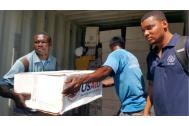 IOM distributes USAID emergency kits to storm-devastated towns in Haiti. Photo: IOM
