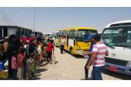 IDPs in Kirkuk wait to board IOM buses. Photo: IOM