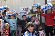 IOM distributes toys donated by South Korea to displaced Iraqi children in Erbil. Photo: IOM