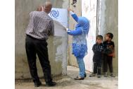 A returning Iraqi family renovates their home with IOM assistance. Photo: IOM