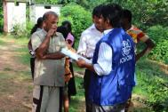 IOM staff interview flood displaced families at an evacuation center in a local school. Photo: IOM / Upali Jayasuriya  2016