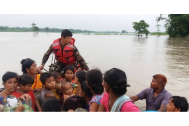 Nepalese army officer assists flood-affected in Jhapa, Nepal. (Pic Nepalese Army via Reuters)