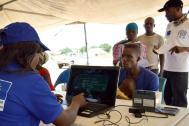 IOM staff register IDP's in an IDP site in northeast Nigeria. Photo: Julia Burpee / IOM