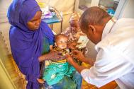 A doctor vaccinates a baby at an IOM clinic in the Digaale IDP settlement in Hargeisa, Somaliland. IOM programmes build the capacity of government health systems and provide health services to vulnerable Somali migrants, returnees and affected communities. Photo: Mary-Sanyu Osire / IOM.