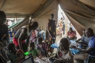 IOM registers new arrivals at the PoC site in Bentiu. © IOM/Bannon 2015