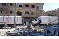 Syrian Arab Red Crescent (SARC) trucks loaded with UN, ICRC and IOM food, nutritional supplements, medical, educational and hygiene supplies reach Harasta in Rural Damascus. Photo: SARC 2016