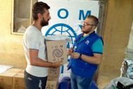 IOM together with  international partners distribute non-food items to people displaced by escalating violence in Aleppo. Photo: IOM