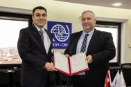 IOM Turkey Chief of Mission Lado Gvilava (right) signs Migrant Presence Monitoring agreement with Atilla Toros, Turkey's Director General of Migration Management. Photo: IOM