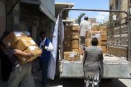 The UN Migration Agency (IOM) unloads medicines and medical supplies donated to the Al-Jumhori Hospital in Sana'a, Yemen. Photo: UN Migration Agency (IOM)
