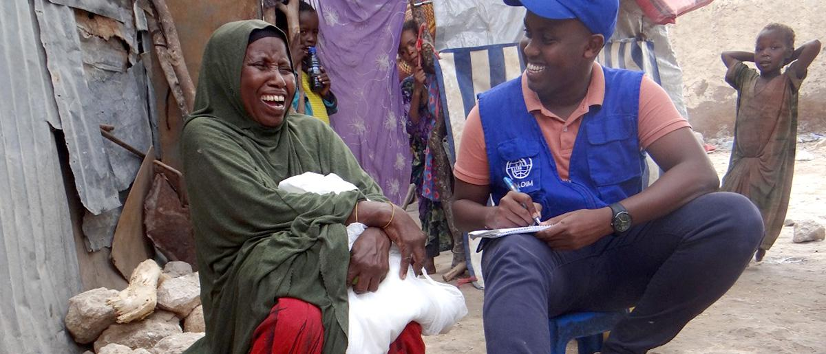 A happy conversation with a beneficiary after distribution of health assistance.