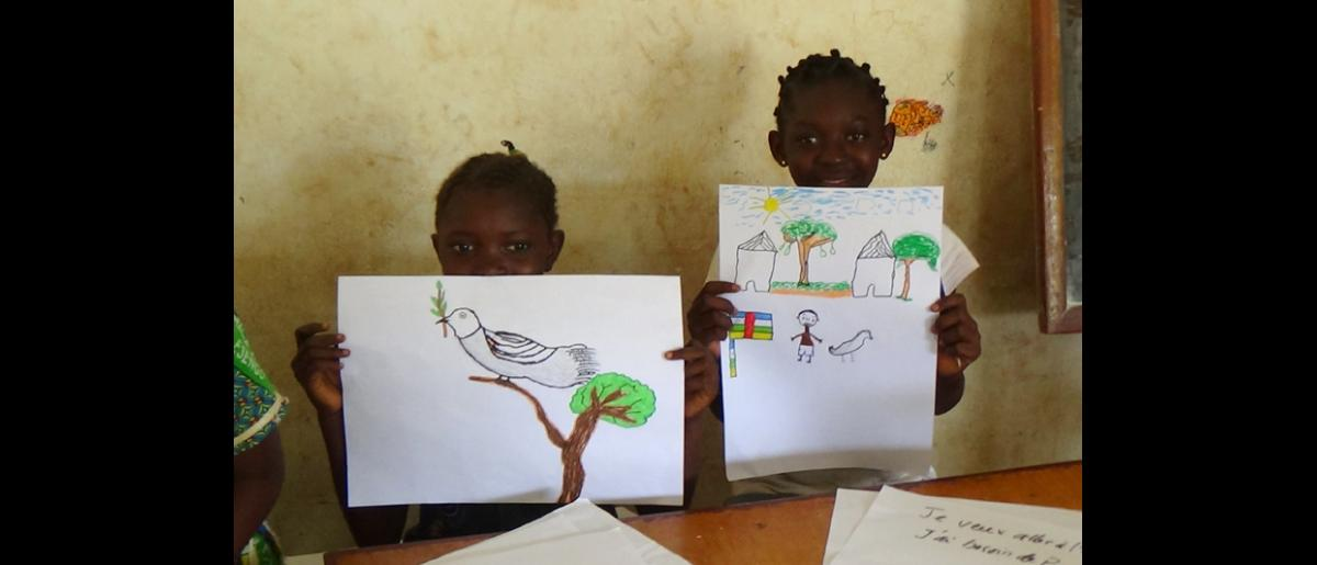 "Many children drew birds of peace, while others drew their own homes, always including a Central African flag. The children also wrote songs about peace, and one group performed a song at the ""Mega-Concert"" in the fifth district on August 30. © IOM 2014 (Photo by Nina Papachristou)"