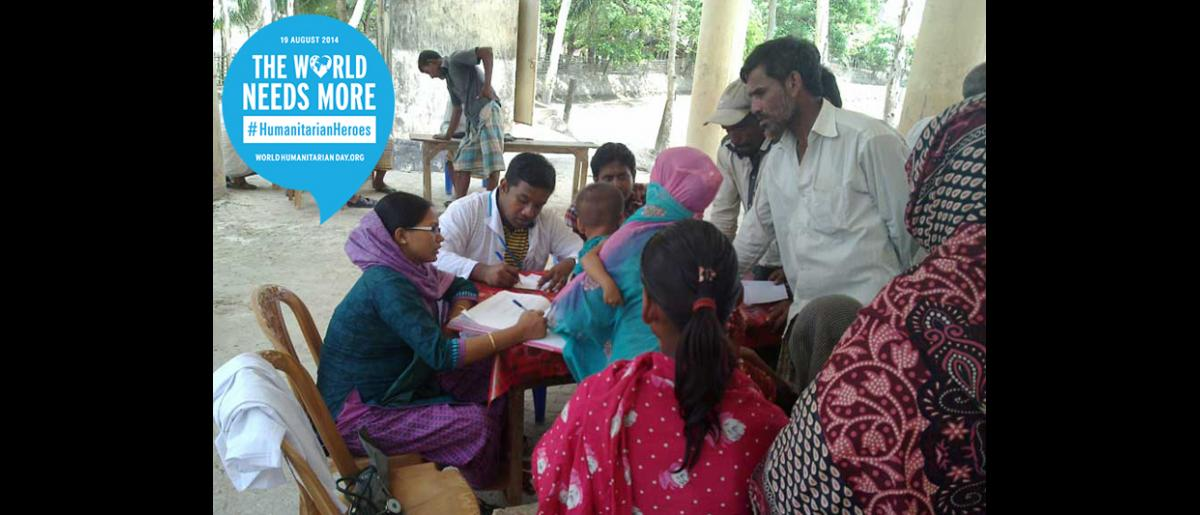 Somen Palit, Emergency Health Physician - BANGLADESH.   Dr Palit (sitting with the white robe) works with a mobile medical team in Upazilas, Cox's Bazar district in Bangladesh. He provides primary health consultations to vulnerable people in the community through health assessments and examination.