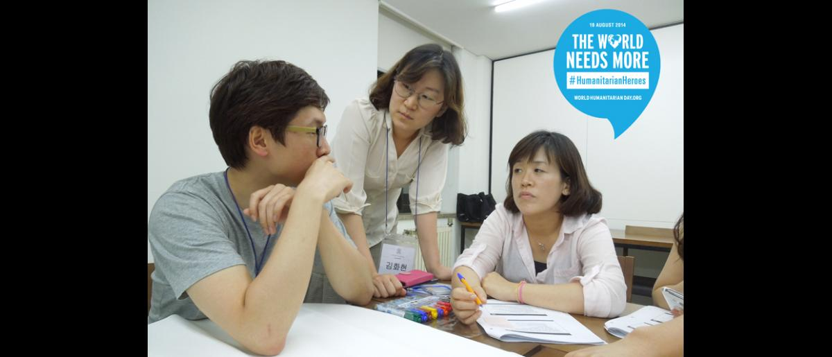 Hwahyun Kim, Project Coordinator - REPUBLIC OF KOREA. Hwahyun (in the middle) facilitates capacity-building programmes for humanitarians. In her work, she organizes training to give people skills for use in the field, as well as publishing humanitarian manuals and tools.