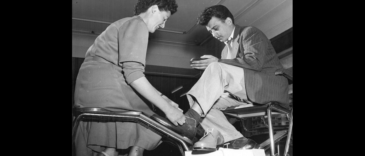 Refugees are provided with shoes and clothing when arriving at the camps in Austria. Photo © USIS 1958 – HAT0165