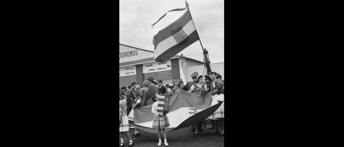 The Hungarian reception committee in folk costumes welcome more refugees at Techo Airport, Bogota. Photo © Dinape 1957 – HCO0018