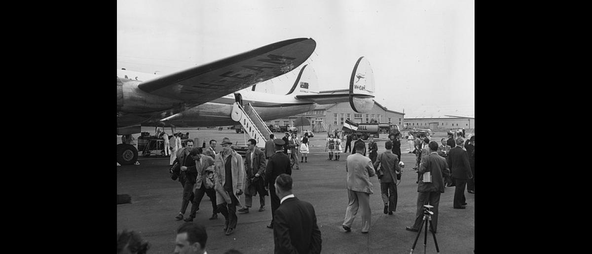 The first batch of 90 Hungarian refugees arrive at Sydney Airport by QANTAS Super Constellation.ICEM chartered buses will take the migrants to Scheyville. Photo © Australian Official Photograph 1956 – HAU0302 – T. Hood