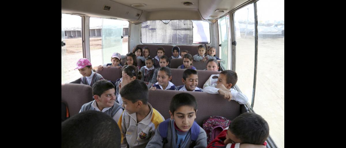 Hundreds of Syrian families living in camps have faced difficulties sending their children to school. To address this concern, IOM organized a transport initiative where fleets of school buses bring children to school everyday. Before the transportation