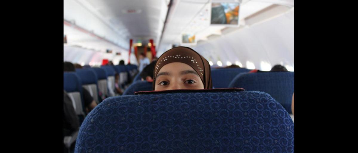 En el primer vuelo de refugiados que partió con destino a Alemania se encontraban 30 hombres, 40 mujeres, 34 niños y 3 bebés. © OIM 2013 (Fotografía de Samantha Donkin)