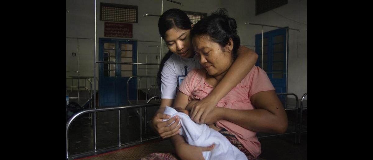"""Promoting Safe Delivery: """"I am 41, this is my first baby. I was told at the village by the young volunteer I could get good health care here at the hospital, so I decided to come for my first visit 7 months ago and came back 3 more times. Everything went well."""" Daw Mar Mar Htay, mother of a 4-day-old child, Ka Don Ka Ni Station Hospital, Bogale Township © IOM 2013 (Photo by Valeria Turrisi)"""
