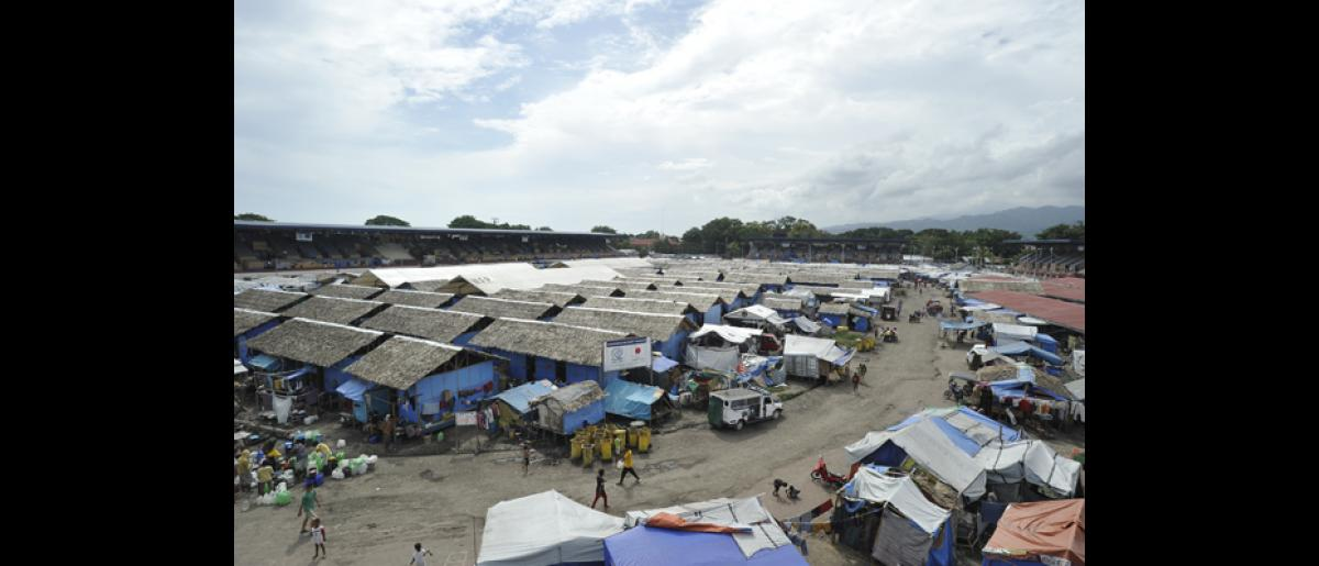 A year after the conflict between Government troops and separatist rebels of the Moro National Liberation Front, the Joaquin Enriquez Sports Complex in Zamboanga City still houses over 2,000 displaced families waiting to be transferred to transitional shelter sites. © IOM 2014 (Photo by Alan Motus)