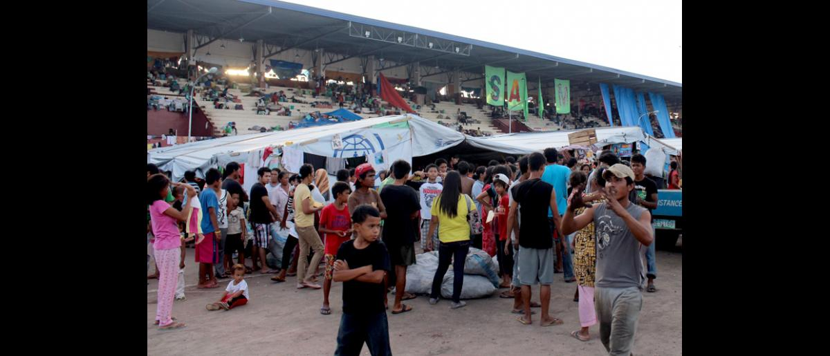 IOM's distribution point in the Joaquin F Enriquez Memorial Stadium in Zamboanga, where thousands of people are still displaced following heavy fighting in the Philippines sixth-largest city. IOM provides health services, charcoal, stoves and other non-food items. © IOM 2013 (Photo by Joe Lowry)