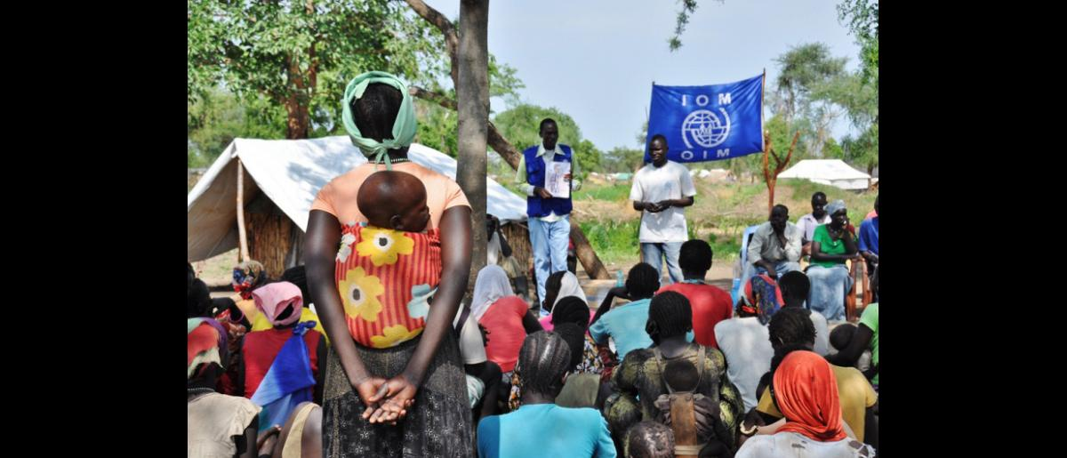 IOM conducts a hygiene promotion session at a village in Doro Refugee Camp. IOM trains and employs refugees to act as hygiene promoters and community mobilizers in the camp. © IOM 2012