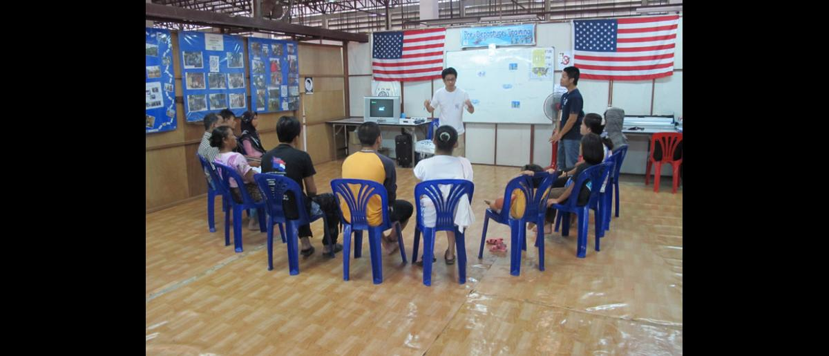 IOM staff run a pre-departure orientation session at the refugee processing centre in Mae Sot, northern Thailand. © IOM 2012