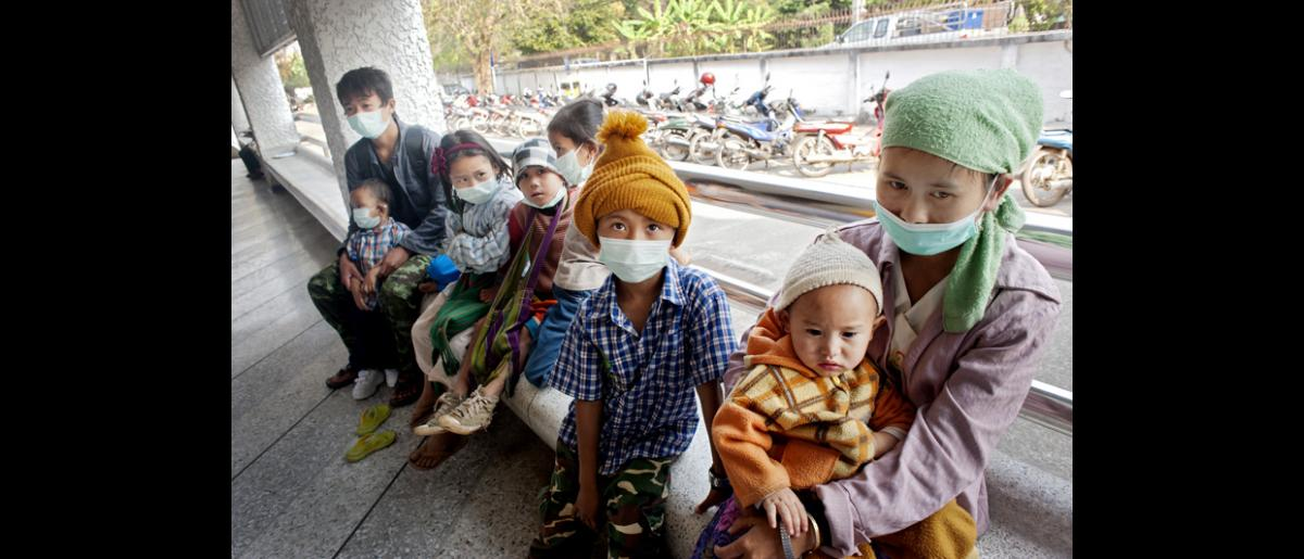 A family of eight waits in line during TB screening at Mae Hong Son hospital. The father, extreme left, was diagnosed sputum positive at the IOM laboratory. © Mikel Flamm 2013
