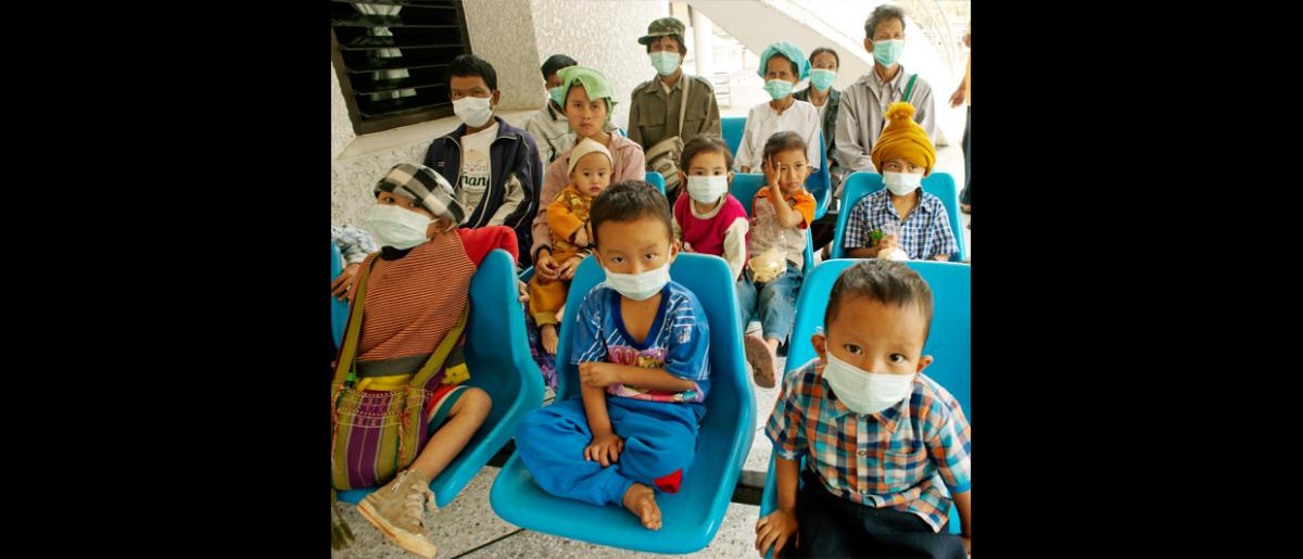 Children wait to be medically screened as part of routine TB testing for the refugee community in Mae Hong Son. © Mikel Flamm 2013