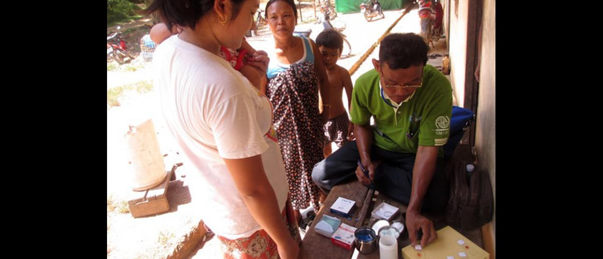 A Myanmar migrant health worker conducts blood tests in Phang Nga. Malaria is typically diagnosed by the microscopic examination of blood using blood films, or with antigen-based rapid diagnostic tests. © IOM 2014