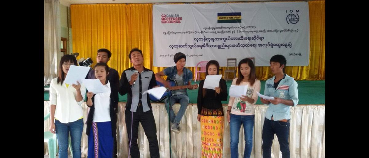 Youth volunteers practicing a song written at a media workshop conducted by IOM in collaboration with DRC and the Myanmar Central Body for Suppression of Trafficking in Persons Division (CBTIP). IOM partnered with Kachin youth groups to develop the campaign following a request from community groups to address human trafficking in the state.
