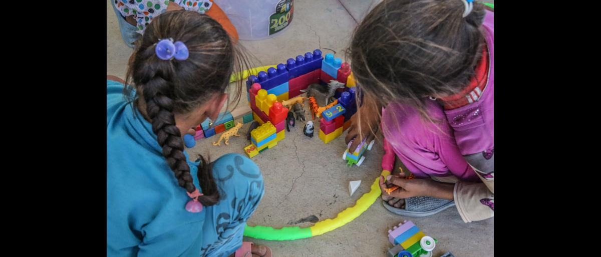 Wasan plays with other children at the IOM psychosocial center at Chamakor camp for displaced Iraqis, east of Mosul.