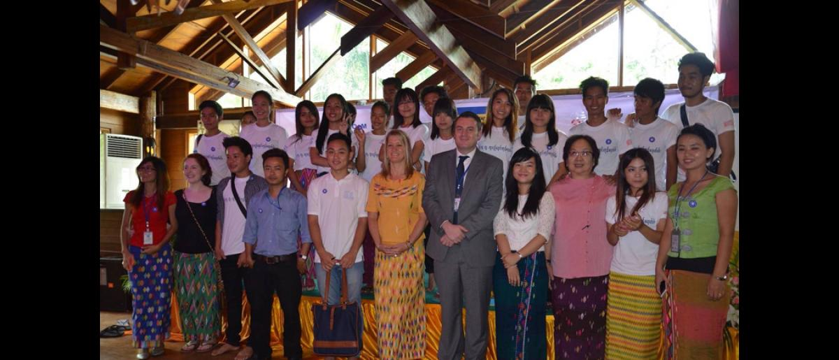 Youth volunteers posing with representatives from IOM and DRC at the launch of the information campaign. The ceremony was presided by Colonel Than Aung, Kachin State Minister for Security and Border Affairs, and Police Brigadier General Win Naing Tun, Joint Secretary of CBTIP.