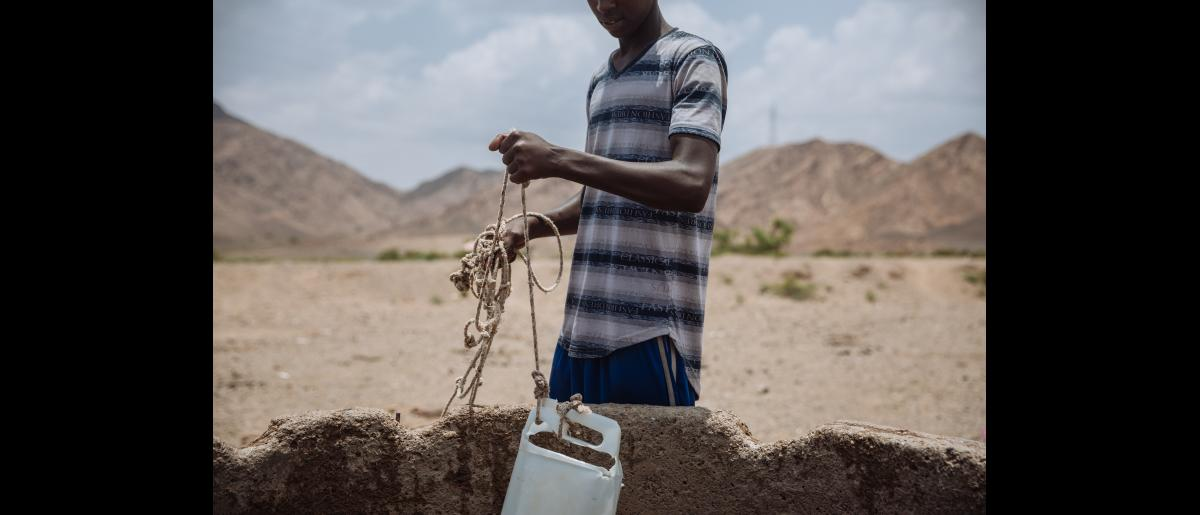 Abdi pulls water out of a well in Southern Djibouti, near the Ethiopian border. Taking a rest after a long walk, the 15 year old Somali joined another group of underaged migrants along the path. He hopes to join his father who lives in Djibouti and find some kind of work to earn a living and hopes to never have to go back to Somalia