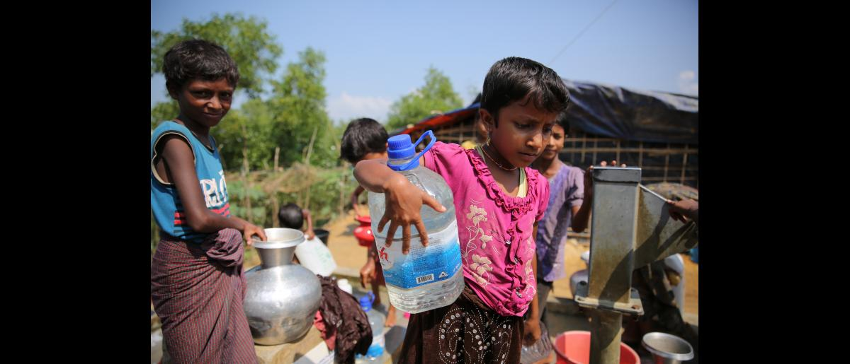Children collect water at an IOM well in Kutupalong Rohingya refugee settlement, Cox's Bazar, Bangladesh.