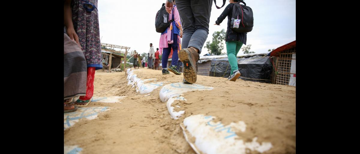Sandbags reinforces slopes, provide paths and stairs in Balukhali Rohingya refugee settlement, where mud slides are a concern.