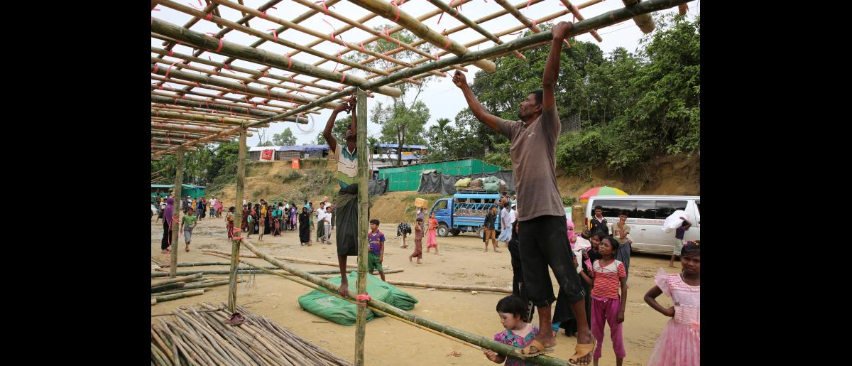 IOM day labourers from the Rohingya refugee community construction a centre for new arrivals to processed and assisted at Balukhali settlement