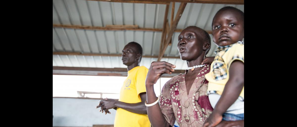 """HIV community mobilisers  The team has 30 women and 2 men. During the meeting, they discuss the best way to approach community and challenges they face. """"Men refuse to come to the clinic even when they are ill. We should create a group only for men, to motivate them,"""" says one of the community mobilisers."""