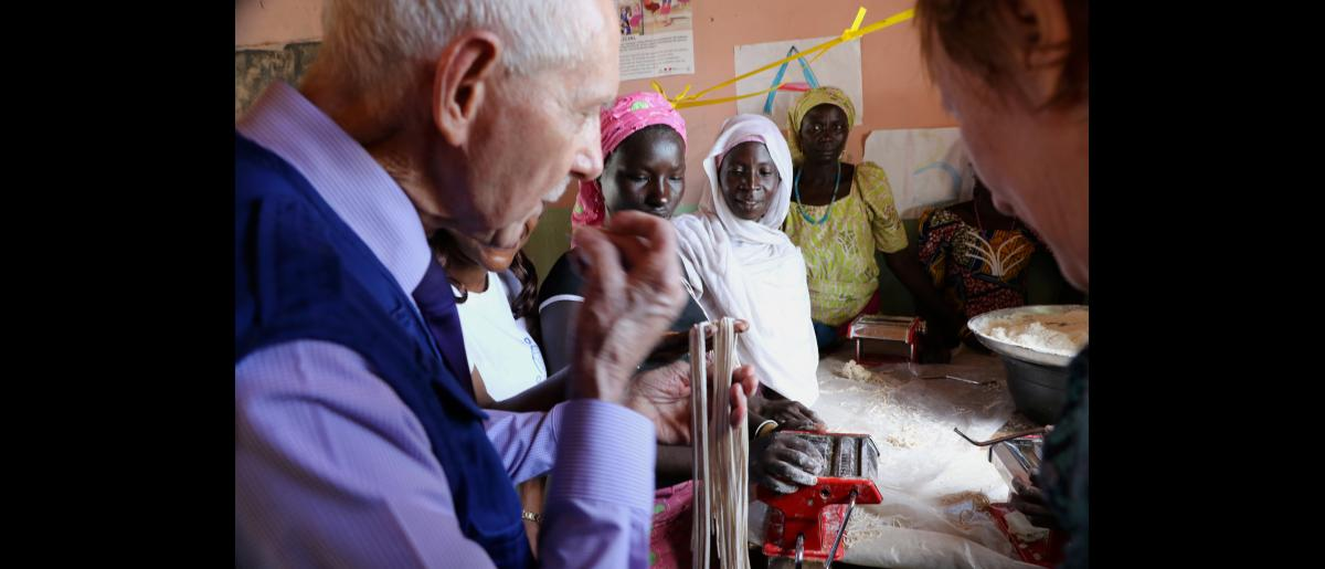 IOM Director General William Lacy Swing spent three days meeting with some of the internally displaced at camps and in communities in the hardest hit areas of Borno state, the epicentre of the conflict. IOM's emergency response is based in Maiduguri, the capital of Borno and the birthplace of Boko Haram.  Pasta making workshop at an IOM safe space in a camp in Gwoza town.  Photo: Julia Burpee / UN Migration Agency (IOM) 2017