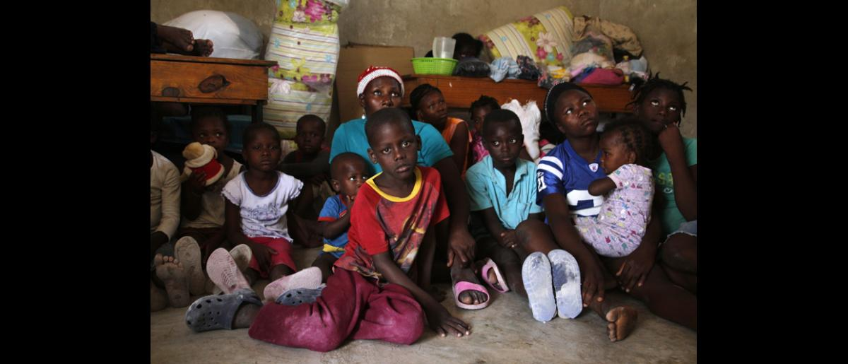 Children and women hosted at the Fond Bayard school, where they sought shelter after returning from the Dominican Republic in June 2015. © IOM/Ilaria Lanzoni 2015