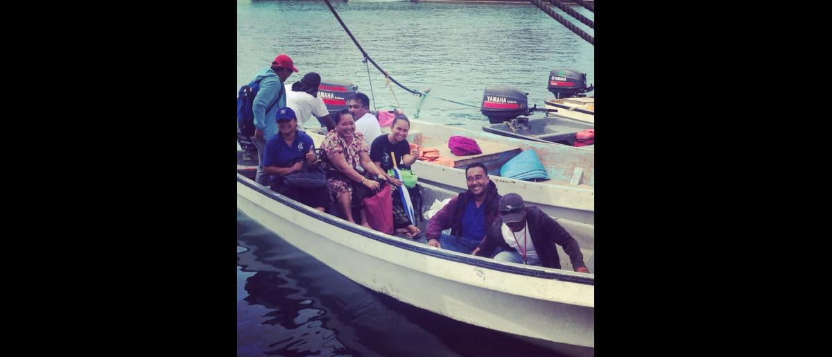 The only way is by boat: IOM Chuuk staff and community  members board a speedboat to get to the handover ceremony on Tonoas island – halfway between the Philippines and Hawaii.