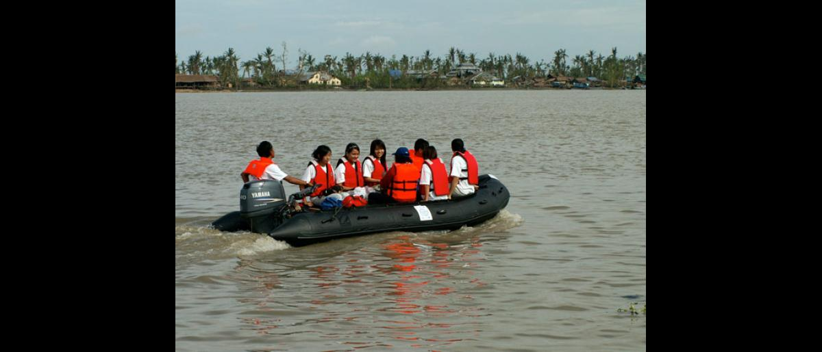 REACHING OUT TO REMOTE AREAS. To access remote areas in the Delta, IOM mobile medical teams, like this one, use Zodiac inflatable boats as well as other motorized boats to bring in medical assistance and relief supplies to cyclone survivors. © IOM 2008 - MMM0141