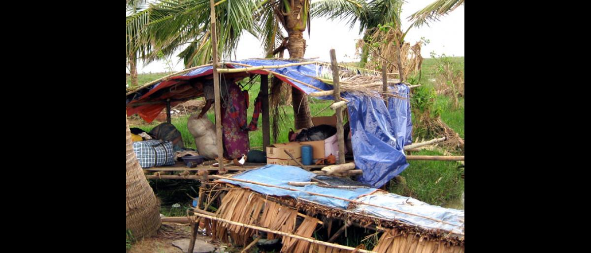 IN DIRE NEED OF SHELTER. Cyclone survivors do with what they have. When Cyclone Nargis struck Myanmar on 2 May 2008, victims of the tragedy constructed temporary shelters after rains and winds destroyed their homes. © IOM 2008 - MMM0121