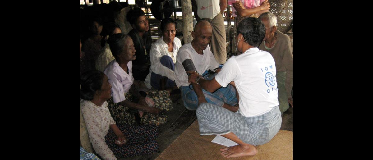 Assisting the Elderly</b> An IOM medical staff gives an elderly man in the village a routine check. Cyclone survivors in the Delta often suffer from the effects of unclean water and food, lack of proper shelter and clothing, and a lack of proper sanitation. © IOM 2008 - MMM0112