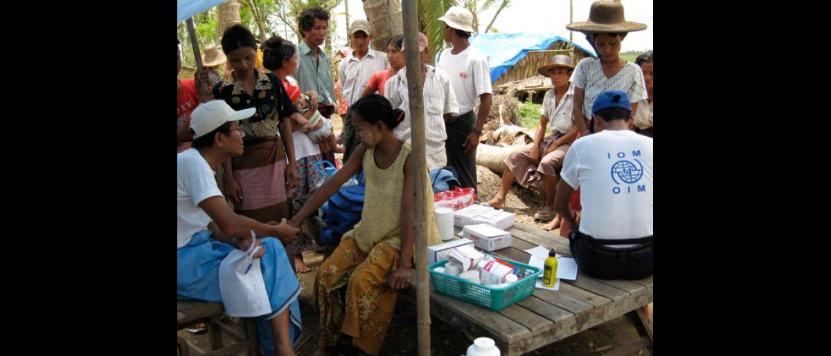 ASSESSING HEALTH CONDITIONS. Members of the IOM medical staff interview cyclone survivors to help them determine the specific medical assistance they can provide. Most of the villagers in the Delta suffer from the effects of unclean water and food, lack of proper shelter and clothing, and a lack of proper sanitation. © IOM 2008 - MMM00108